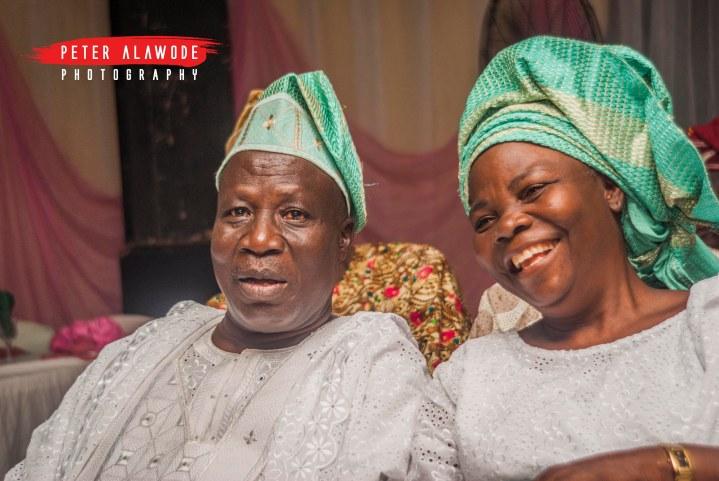 the brides parents share a laugh